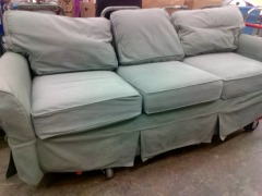 OLIVE GREEN SOFA WITH SLIP COVER
