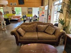 Overstuffed Camelback sofa