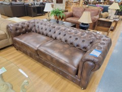 NEW LUCIOUS FAUX LEATHER UPHOLSTERED SOFA (RETAIL $1,400)