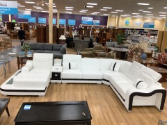 New WHITE & BLACL SYDNEY LARGE LEATHER SECTIONAL SOFA JUBLIEE FUR. ( NEW) RETAIL:3,600 small tear in back